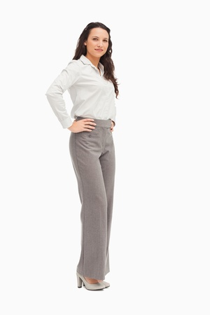 Portrait of an employee arms on hips against white background photo
