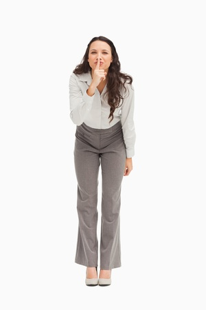 Portrait of an employee keeping a secret against white background Stock Photo - 13674750