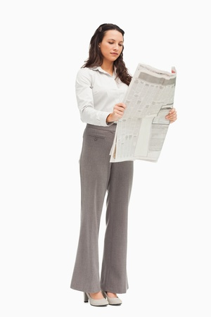 Employee reading the news against white background photo