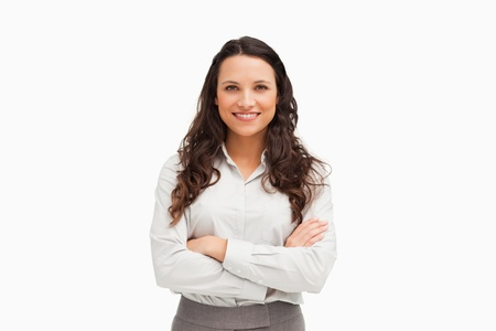 Portrait of an employee with folded arms against white background photo