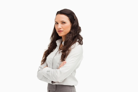 Portrait of a brunette businesswoman with folded arms against white background Stock Photo - 13674644