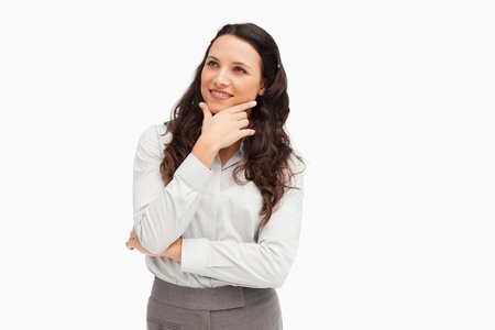 Cute smiling businesswoman posing against a white background photo