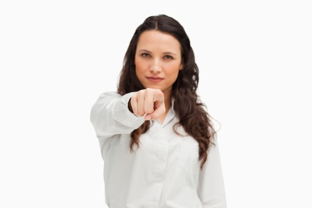 Portrait of a brunette pointing against white background  photo