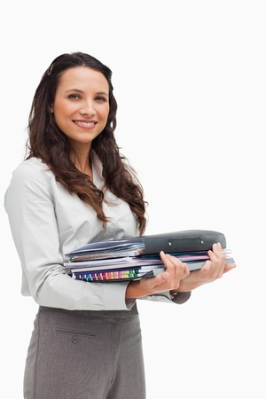 Portrait of a brunette carrying a lot of files  photo