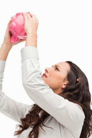 Empty piggy bank against white background photo