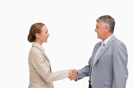 Business people shaking their hands against white background photo