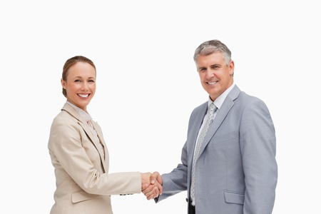 Portrait of business people shaking their hands against white background photo