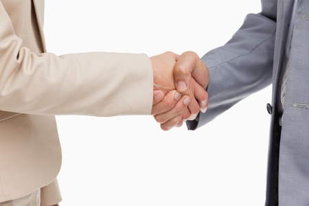 Close-up of people shaking their hands against white background photo
