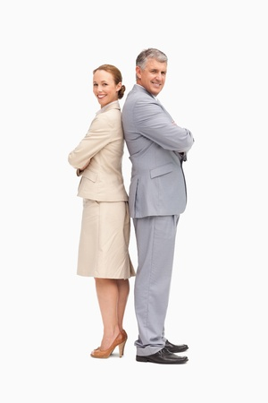 Portrait of smiling business people back to back against white background photo