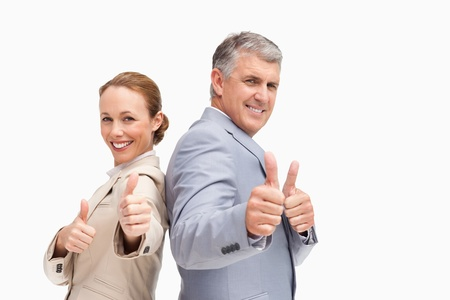 Portrait of business people approving back to back against white background Stock Photo - 13674370