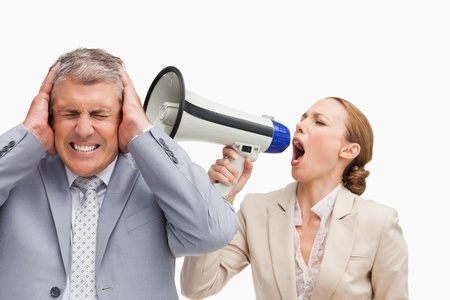 Businesswoman screaming with a megaphone after her colleague against white background Stock Photo - 13672451