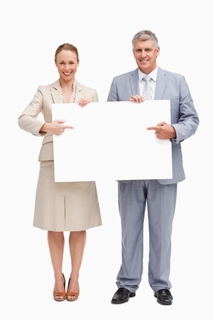 Business people showing a poster against white background photo
