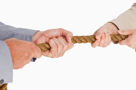 People in suit pulling the rope against white background photo