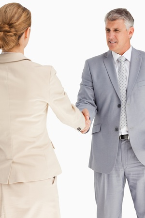 Business people having an agreement against white background photo