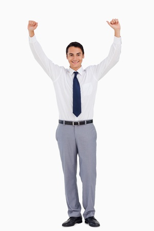front raise: Businessman raising his arms against white background