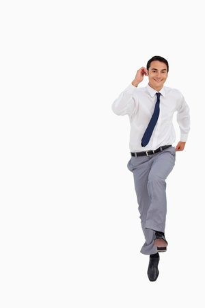 front raise: Businessman running against white background Stock Photo