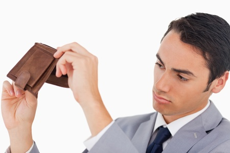 Man in a suit with his wallet empty against white background photo
