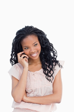 A young woman is smiling and talking on the mobile phone Stock Photo - 13674060