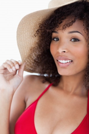 Smiling young woman in swimsuit looking at the camera against a white background photo