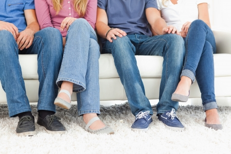 A group photo with the camera focusing on the people's feet and legs Stock Photo - 13710770