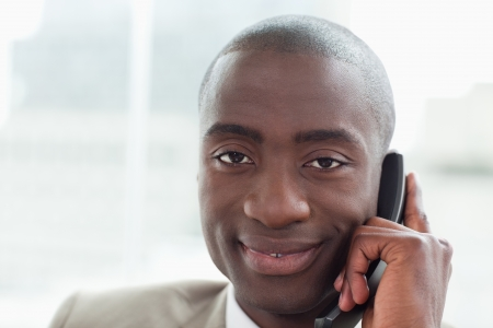 Close up of a businessman on the phone in his office photo