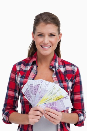 Portrait of a woman holding bank notes against a white background photo