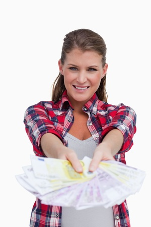Portrait of a rich woman showing bank notes against a white background photo