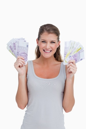 Portrait of a woman showing bank notes against a white background photo