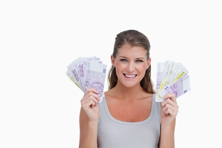 Woman showing bank notes against a white background photo
