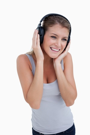 Portrait of a woman listening to music against a white background photo