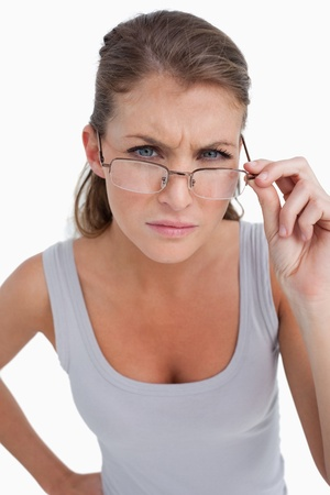 Portrait of a serious woman with glasses against a white background photo