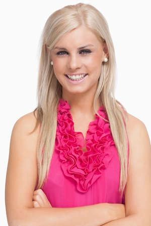 Smiling blonde arms crossed against white background photo