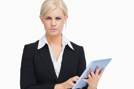 Seus businesswoman holding a tablet computer against white background Stock Photo - 15551737
