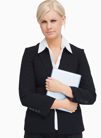 Serious businesswoman holding a tactile tablet against white background Stock Photo - 15551720