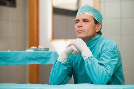 solicitous: Thoughtful surgeon sitting in a operating theater in a hospital Stock Photo