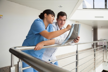Nurse asking the doctor about x-ray in hospital corridor Stock Photo - 15591804