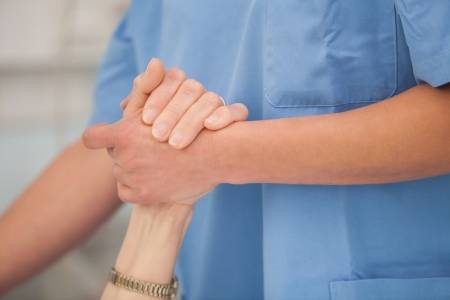 take care: Nurse holding the hands and take care of the elderly woman
