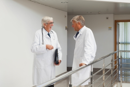 Doctors are talking to each other in the corridor Stock Photo - 15591345