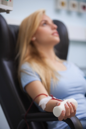 Woman sitting back while getting dialysis in hospital Stock Photo - 15591493