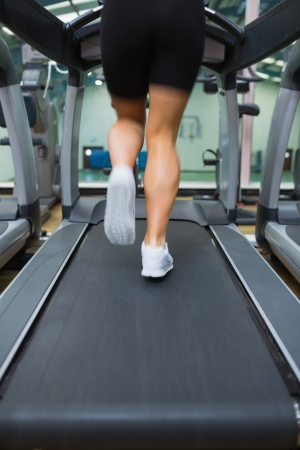 Legs running on a treadmill