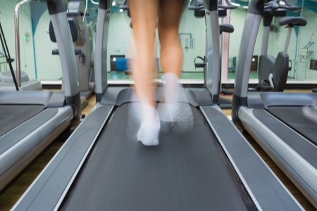 Running on a treadmill in the gym photo