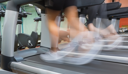 People jogging on a treadmill in the gym photo