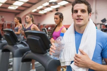 perspiring: Man smiling in gym after exercising