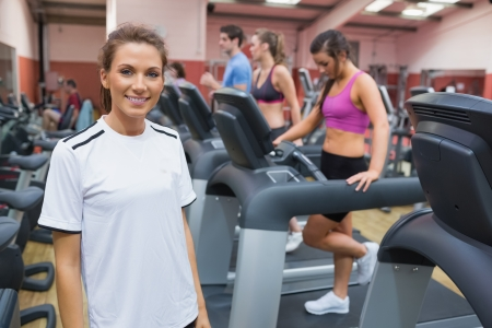 active lifestyle: Woman wearing white t-shirt smiling in the gym