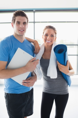 happy client: Trainer with a happy client in gym Stock Photo