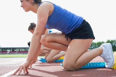 Women beginning to run in the stadium Stock Photo - 15591881