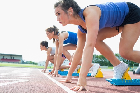 Women ready to race on track field  Stock Photo - 15592236