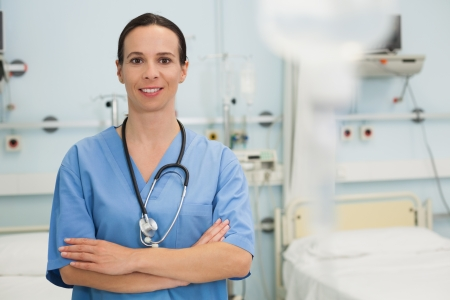 female catheter: Smiling female nurse in hospital ward