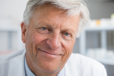 Smiling mature doctor photo