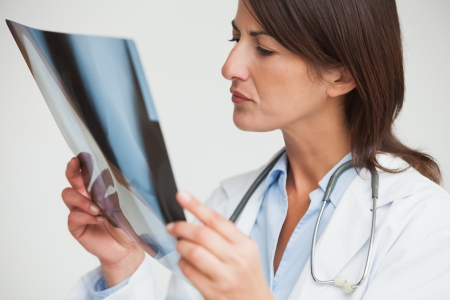 Female doctor studying x-ray in hospital Stock Photo - 15590739